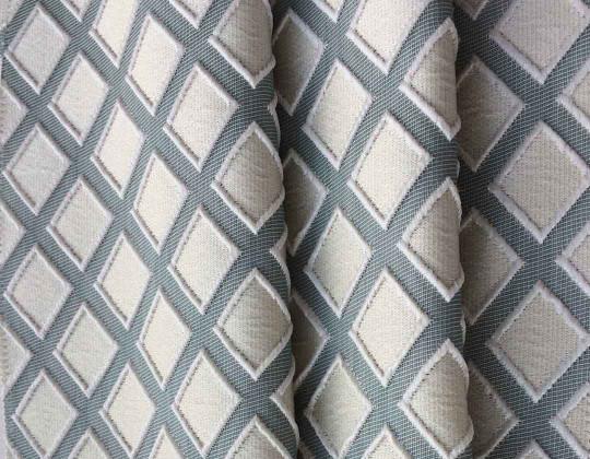 Портьєрна тканина  Mira ромб молочний, фон синьо-зелений